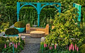 CHELSEA FLOWER SHOW 2017: 500 YEARS OF COVENT GARDEN DESIGNED BY LEE BESTALL - COTTAGE GARDEN, FORMAL, BLUE, PAINTED, ARCH, ARCHES, CHAIRS, RATTAN, FURNITURE, RELAXING, LUPINS