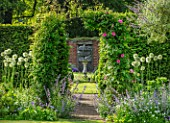 COTTAGE ROW, DORSET: ARCH WITH CLEMATIS MADAME JULIA CORREVON, SUNDIAL AND WALL. FRAMED, VIEW, CLIMBERS, CLIMBING