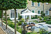 THE OLD RECTORY, QUINTON, NORTHAMPTONSHIRE: DESIGNER ANOUSHKA FEILER: SUNKEN PATIO, STIPA LESSINGIANA, CLIPPED HORNBEAM, OUTDOOR LOUNGE, FURNITURE, LIVING, AREA, SUN SHADE