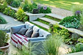 THE OLD RECTORY, QUINTON, NORTHAMPTONSHIRE: DESIGNER ANOUSHKA FEILER: SUNKEN PATIO, OUTDOOR LOUNGE, STEPS, MIND YOUR OWN BUSINESS, SETTEE, CUSHIONS, POLYSTICHUM PLUMOSOMULTILOBUM