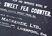 ROGER PARSONS SWEET PEAS, WEST SUSSEX: OLD METAL SWEET PEA COUNTER BOX