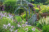 WOLLERTON OLD HALL, SHROPSHIRE: GATE, SUNDIAL GARDEN, SUMMER, ENGLISH, COTTAGE, BORDERS, PHLOX, GRASS, LAWN, PERGOLA, BUILDING, PAGODA, WOODEN, TIMBER, FRAMED, GAZEBO