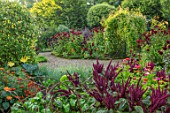 MORTON HALL GARDENS, WORCESTERSHIRE: KITCHEN GARDEN IN LATE SUMMER. BEDS WITH AMARANTHUS, ZINNIAS. WALL, WALLED, COUNTRY, HOUSE, CLASSIC, VEGETABLE, DARK, RED, DAHLIAS
