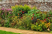 PARHAM, SUSSEX: PATH, HOT BORDER - TITHONIA TORCH, DAHLIA BISHOP OF LLANDAFF, SEDUM MATRONA, HELIANTHUS LEMON QUEEN, AGASTACHE BLACK ADDER, BORDERS, WALLED, GARDEN