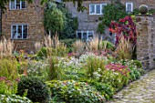 PETTIFERS, OXFORDSHIRE: HOUSE, BORDER, CALAMAGROSTIS, SEDUMS, ASTRANTIAS, COTINUS, BORDERS, FALL, AUTUMN, LATE, SUMMER, PATH, ENGLISH, COUNTRY, GARDEN