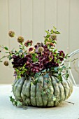 FLOWER FILLED GREEN PUMPKIN ON GREEN TABLE: DAHLIAS, ZINNIAS, IVY, HYDRANGEA, DECORATIVE, DECORATION, DECORATED, AUTUMN, FALL, EDIBLE, CUCURBITA, HARVEST, PUMPKINS, OCTOBER