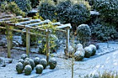 MORTON HALL GARDENS, WORCESTERSHIRE: VIEW DOWN ONTO SOUTH GARDEN. PERGOLA, ARBOUR, NOVEMBER, FROST, COLD, TOPIARY, CLIPPED, ENGLISH, COUNTRY, GARDEN