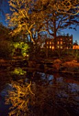 MORTON HALL, WORCESTERSHIRE: NIGHT TIME, LIGHTS, LIGHTING, EVENING, WATER, GARDEN, COUNTRY, HOUSE, TREES, POND, POOL, REFLECTIONS, REFLECTED