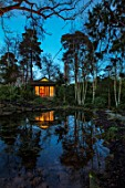 MORTON HALL, WORCESTERSHIRE: NIGHT TIME, LIGHTS, LIGHTING, EVENING, WATER, GARDEN, COUNTRY, HOUSE, TREES, POND, POOL, REFLECTIONS, REFLECTED, JAPANESE TEA HOUSE