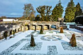 ABERGLASNEY GARDENS, CAMARTHENSHIRE, WALES. CLOISTER GARDEN IN SNOW. FEBRUARY, KNOT, KNOTS, PARTERRE, GRASS, FORMAL ,TRIMMED SHAPES