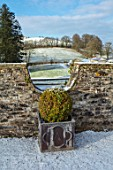 ABERGLASNEY GARDENS, CAMARTHENSHIRE, WALES. PARAPET WALK IN SNOW, FEBRUARY, LEAD CONTAINERS, TOPIARY, CLIPPED, BOX, BUXUS