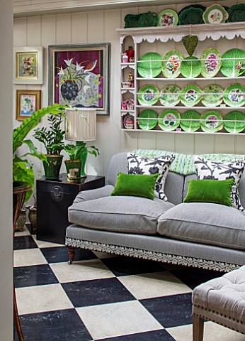 BUTTER_WAKEFIELD_HOUSE_LONDON_THE_CONSERVATORY__GREY_SOFA_CUSHIONS_CHEQUERBOARD_FLOOR_PLATES_WALL_CU