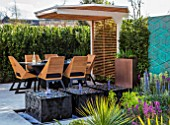 ASCOT SPRING GARDEN SHOW: DESIGNER TOM HILL. COURTYARD, DINING AREA, CANOPY, TABLE, CHAIRS, WATER FEATURE, ENCLOSED, PRIVATE, SCREENS, SCREENING, SCREENED, SMALL, TOWN, URBAN
