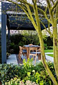 ASCOT SPRING GARDEN SHOW: DESIGNER CATHERINE MACDONALD: PATIO, DINING AREA, TABLE, CHAIRS, CANOPY, PERGOLA, BLACK, PAVING, SCREENING, SCREENS, ENTERTAINING, SPRING, WOODLAND