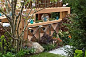 ASCOT SPRING GARDEN SHOW: GARDEN DESIGNED BY KATE GOULD: WOODEN WINE RACK, SCREENS, SCREENING, DINING, FORMAL, URBAN, SMALL, CHERRY, PRUNUS
