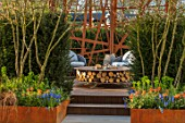 ASCOT SPRING GARDEN SHOW: GARDEN DESIGNED BY KATE GOULD: CORTEN STEEL SCREEN, BAMBOO DECK, SUSTAINABLE, SMALL, FORMAL, URBAN, TOWN, HEDGES, HEDGING, SEATING, ZERO CIRCULAR FIRE PIT