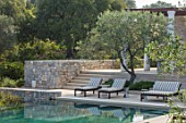PORTO HELI, GREECE, DESIGNER THOMAS DOXIADIS: VILLA GARDEN. SWIMMING POOL, LOUNGERS, GREEK, LANDSCAPE, OLIVES, WALLS
