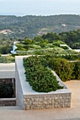 PORTO HELI, GREECE, DESIGNER THOMAS DOXIADIS: VILLA GARDENS. VIEW ONTO GREEN ROOFS OF VILLAS, LANDSCAPE. MEDITERRANEAN, WILD, DRY, GREEK,OLIVES, LIVING ROOF
