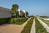 PORTO HELI, GREECE, DESIGNER THOMAS DOXIADIS: VILLA GARDEN - ROSEMARY, CLIPPED HEDGES, HEDGING OF PISTACIA LENTISCUS, LANDSCAPE, GREEK, MEDITERANEAN