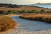 ANTIPAROS, GREECE, DESIGNER THOMAS DOXIADIS: DRIVE EDHED WITH GRASSES, DAWN, GREEK, LANDSCAPE, HYPARRHENIA HIRTA