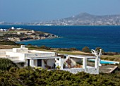 ANTIPAROS, GREECE, DESIGNER THOMAS DOXIADIS:WHITE PAINTED VILLA WITH WHITE METAL OLIVE TREE SCULPTURE, SEA, GREEK, LANDSCAPE