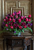 PARHAM HOUSE AND GARDENS, SUSSEX: FLOWER ARRANGEMENT WITH TULIPA BLACK HERO, TULIPA CAPE HOLLAND, HONESTY AND ACANTHUS. SPRING, CUTTING