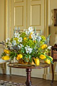 PARHAM HOUSE AND GARDENS, SUSSEX: FLOWER ARRANGEMENT WITH TULIPA  MRS JOHN T SCHEEPERS, VARIEGATED EUONYMUS, CAMASSIA, NARCISSUS POETICUS VAR. RECURVUS. SPRING, CUTTING