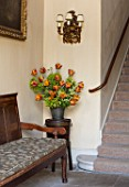 PARHAM HOUSE AND GARDENS, SUSSEX: FLOWER ARRANGEMENT WITH TULIPA BROWN SUGAR, RHUBARB FLOWERS, EUPHORBIA, SPRING, CUTTING