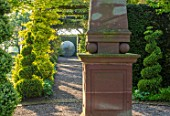 MITTON MANOR, STAFFORDSHIRE: PATH, TOPIARY, AVENUE, FORMAL, COUNTRY, BOX, TOPIARY, HEDGES, HEDGING, EVERGREEN, SPRING, OBELISK, STEEL, ALLIUM, SPHERE, SCULPTURE BY RUTH MOILLIET