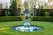 MITTON MANOR, STAFFORDSHIRE: PATH, TOPIARY, AVENUE, FORMAL, COUNTRY, BOX, TOPIARY, HEDGES, HEDGING, EVERGREEN, SPRING, SUMMERHOUSES, POND, POOL, LAWN, CIRCULAR, GLASS WATER FEATURE