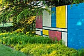 THE MANOR HOUSE, STEVINGTON, BEDFORDSHIRE: SPRING. MONDRIAN WALL, ART, PAINTED, WALLS YELLOW, BLUE, RED, WHITE