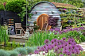 THE MOONGATE GARDEN, SUSSEX: ALLIUM FIRMAMENT, HOBBIT HOUSE, SUMMERHOUSE, SUMMER HOUSE, OUTSIDE ROOM, SHED, DEN, OFFICE, TABLE, CHAIRS, WOODEN, LIVING ROOF, POOL, POND