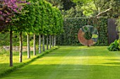 CHILWORTH MANOR, SUSSEX: LAWN, VIEW TO DAVID HARBER SCULPTURE, SPRING