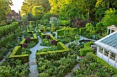 CLAUS DALBY GARDEN, DENMARK: PATHS AND GARDEN ROOMS SEEN FROM THE HOUSE, YEW HEDGES, HEDGING, SPRING, CONSERVATORY, GREENHOUSE