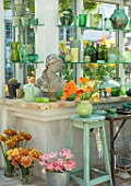 CLAUS DALBY GARDEN, DENMARK: GREENHOUSE, STUDIO - STATUE, EMPTY CONTAINERS FOR FLOWER ARRANGING IN GREEN. TULIPS CAIRO, PEACH BLOSSOM, SENSUAL TOUCH, BROWN SUGAR