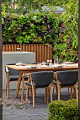 CHELSEA FLOWER SHOW 2018: URBAN FLOW GARDEN, DESIGNER TONY WOODS. TABLE, CHAIRS, PATIO, LIVING WALL, KITCHEN, DINING AREA, ENTERTAINING, SALAD, CROPS, COOKING, COOKERY