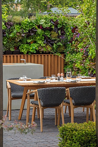 CHELSEA_FLOWER_SHOW_2018_URBAN_FLOW_GARDEN_DESIGNER_TONY_WOODS_TABLE_CHAIRS_PATIO_LIVING_WALL_KITCHE