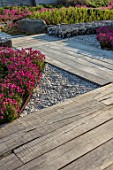 SEASIDE GARDEN DESIGNED BY ANTHONY PAUL: OAK SLEEPERS FOR FLOOR, THRIFT, ARMERIA MARITIMA, PINK, FLOWERS, COASTAL, GARDENS, WHITE PEBBLES, FLOORS, WALKWAY, PATHS