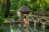ABLINGTON MANOR, GLOUCESTERSHIRE: REFLECTIONS IN RIVER COLN, LAWN, SUMMERHOUSE, SUMMER HOUSE, WOODEN BRIDGE, SUMMER, GREEN, GARDEN, ENGLISH, COUNTRY