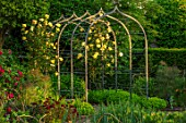 MORTON HALL, WORCESTERSHIRE: KITCHEN GARDEN, POTAGER, ARCH WITH ROSE- ROSA GOLDEN SHOWERS. YELLOW, FLOWERS, FLOWERING, CLIMBER