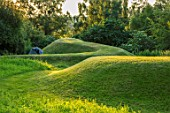 ASTHALL MANOR, OXFORDSHIRE: TURF MOUNDS, SUNSET, LAWN, HILL, HILLS, VIEWING MOUND, GREEN, GRASS