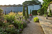 WORMSLEY, BUCKINGHAMSHIRE: THE OPERA GARDEN, DESIGNER HANNAH GARDNER: PATH, YEWS, SUNDIAL, BORDERS, ENGLISH, COUNTRY, GARDEN, SUMMER