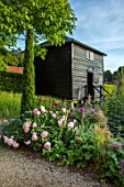 WORMSLEY, BUCKINGHAMSHIRE: THE OPERA GARDEN, DESIGNER HANNAH GARDNER: THE GRANARY, PATH, BORDERS, PEONIES, YEW, ENGLISH, COUNTRY, GARDEN, SUMMER