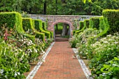 WORMSLEY, BUCKINGHAMSHIRE: FLINT AND BRICK PATH THROUGH THE WALLED GARDEN - BORDER WITH PERENNIALS, SUMMER, ENGLISH, COUNTRY, GARDEN, WALLS, WALLED, YEW HEDGES, HEDGING