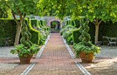 WORMSLEY, BUCKINGHAMSHIRE: FLINT AND BRICK PATH, WALLED GARDEN - TERRACOTTA CONTAINERS, BOX SPIRALS, MALUS HUPEHENSIS, SUMMER, ENGLISH, COUNTRY, GARDEN, YEW HEDGES, HEDGING
