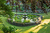 TOWN PLACE GARDEN, SUSSEX: LAWN, CIRCULAR POOL, FOUNTAIN, WATER, POND, RAISED, SUMMER