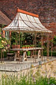 THE WALLED GARDEN AT COWDRAY, WEST SUSSEX: SEATING AREA WITH RUSTY METAL PERGOLA, AWNING, PLACE TO SIT, DINING, AL FRESCO, ENTERTAINING