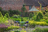 THE WALLED GARDEN AT COWDRAY, WEST SUSSEX: OUTDOOR DINING, SEATING AREA TABLE, CHAIRS, BOX PARTERRES, GREEN, ENGLISH, COUNTRY, GARDEN, AWNING, GAZEBO