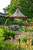 THE WALLED GARDEN AT COWDRAY, WEST SUSSEX: OUTDOOR DINING, SEATING AREA TABLE, CHAIRS, BOX PARTERRES, GREEN, ENGLISH, COUNTRY, GARDEN, AWNING, GAZEBO, AL FRESCO