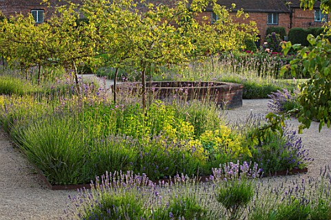 THE_WALLED_GARDEN_AT_COWDRAY_WEST_SUSSEX_PATHS_RAISED_CIRCULAR_POOL_POND_WATER_BORDERS_LAVENDER_VERB